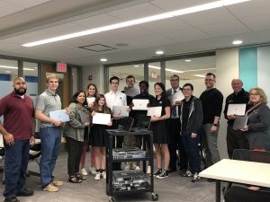 Joe Montgomery, Josh Coryea, and Jeremy Forstner from Outsell IT pictured with DeLaSalle students and staff